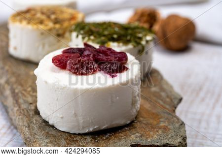 Cheese Collection, Variety Of Fresh White Soft Goat French Cheeses With Aromatic Herbs, Berries And