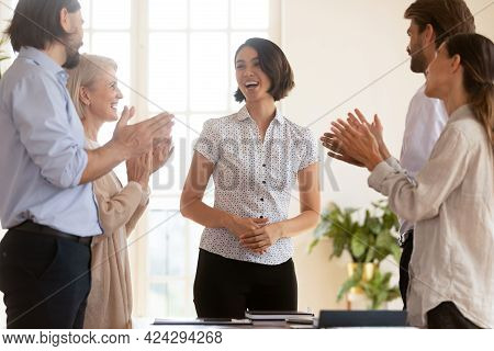 Happy Employees Applauding, Thanking Asian Businesswoman Executive At Meeting