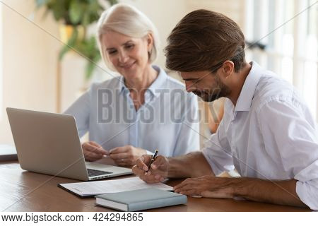 Client Signing Contract With Middle Aged Manager After Successful Negotiation