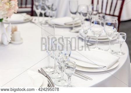 Fancy Table Set For Dinner With Napkin Glasses In Restaurant, Luxury Interior Background. Wedding El