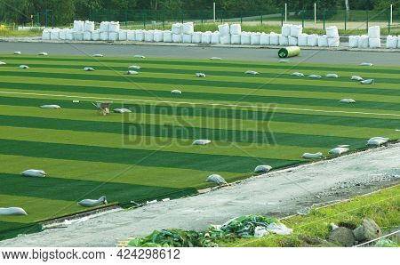 Replacement Of Football Coverage. New Artificial Turf For Playing Soccer.