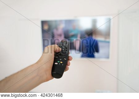 A Person Lying At Home And Watch Tv, Put Legs On The Table, Enjoy And Relax