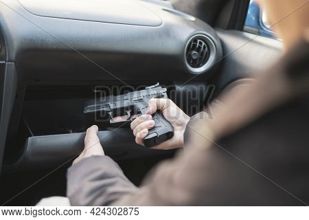 A Crime Concept, Burglar Taking The Pistol And Plannung A Murder