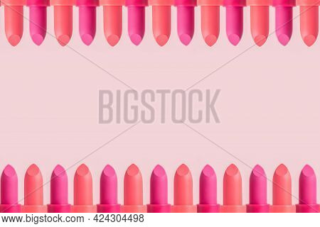 Lipstick Frame On A Pink Background. Summer Decorative Cosmetics For Lips. Set Of Coral And Wine Col