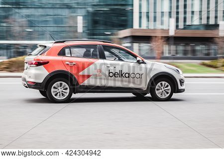 Moscow, Russia - May 2021: Moscow Carsharing Belka Car. Kia Rio Hatchback Rushes Along The Street On