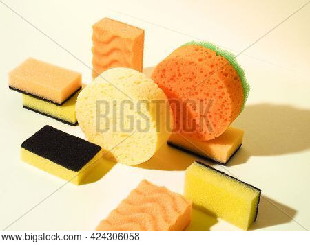 Geometric Composition With Foam Rubber Sponges. Photo An Top Down Angle. Yellow Background. Abstract