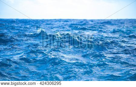 Tropical Blue Ocean In Hawaii. Summer Sea In Clean And Clear Water From Surface For Background. Wave