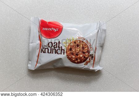 Labuan,malaysia-jun 15,2021:packet Of Malaysia Munchys Oat Krunch Nutty Chocolate Biscuits On White