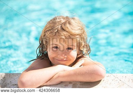 Happy Child Having Fun At Swimming Pool On Sunny Day. Boy Kid Relax In Spa Swim Pool.