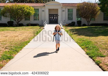 Schoolchild Running On Playground At End Of Class. School Vocation. Kids Education Concept.