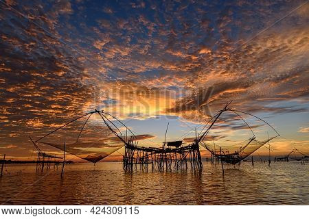 Beautiful Landscape Morning Sky Sunrise, Fishing Using Giant Nets Thale Noi Wetlands At Baan Pak Pra