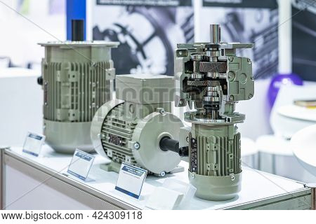 Cross Section Show Metal Cogs Helical Gear Bearing Housing Shaft And Other Detail Inside Of  Transmi
