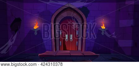 Broken Wooden Door In Medieval Castle. Old Wood Gate In Stone Wall With Flaming Torches At Night. Ve
