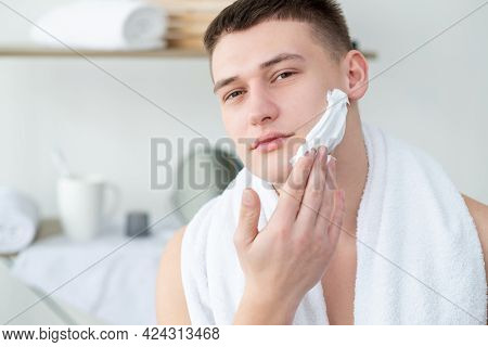 Male Shaving Routine. Skincare Cosmetology. Daily Shave. Confident Shirtless Man With White Towel On