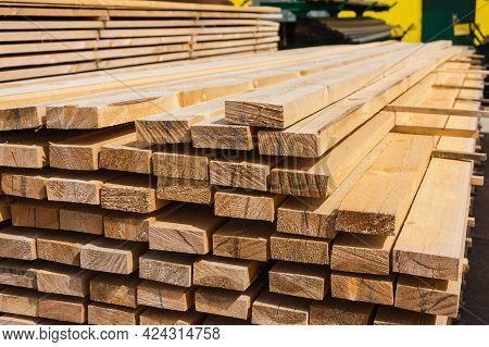 A Stack Of Wooden Boards, Wooden Boards At A Sawmill, A Warehouse Of Boards On The Site Of A Buildin