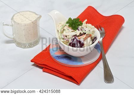 Fresh, Organic Cole Slaw In A Handled Dish With Pitcher Of Dressing On The Side.  Macro View.