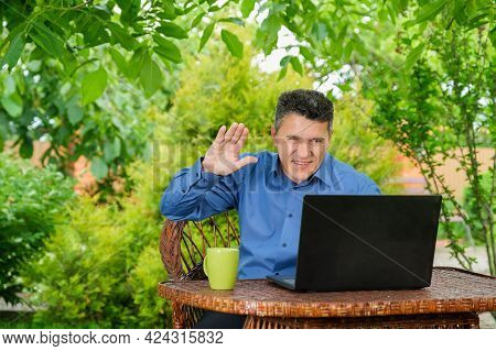 Smiling Mature Caucasian Man Drinking Coffee And Showing Ok Sign With Fingers To Business Partner Vi
