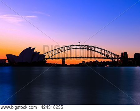 Beautiful Blue Orange Pink Purple Colours Of Sydney Harbour Bridge At Sunset Viewed From The Botanic