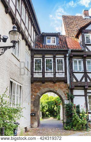 Braunschweig, Germany - July 25, 2020: Little Arch Over A Half Timbered House In Braunschweig, Germa