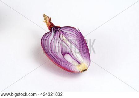 One Half Of A Ripe Raw Unpeeled Onion On A White Background. Italian Onion Ramata Di Milano. Cross-s