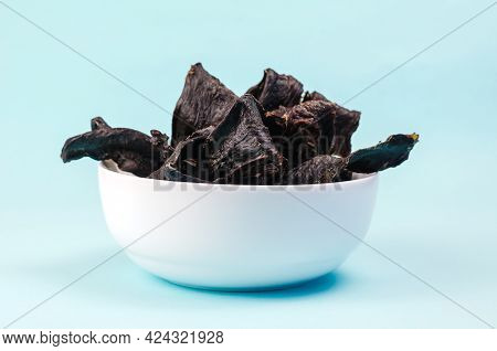 Training Treats For Pets On Blue Background. Natural Air Dried Dog Treats In A White Ceramic Bowl. T