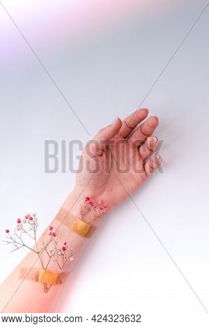 Plaster With Flower On Female Hand. Natural Freshness And Youth Girl Hands, Hand Cosmetics With Flow