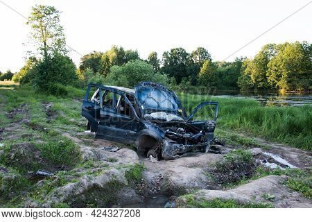 A Wrecked Car, Abandoned On The Road. A Stolen Car
