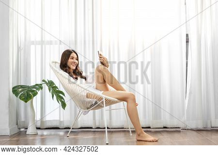 Portrait Of Smiling Happy Beauty Asian Woman Relax Using Digital Technology Smartphone.young Asian G