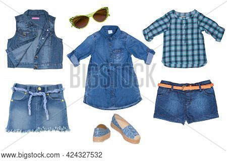 Collage Set Of Blue Jeans Clothes For A Little Girl Isolated On A White Background. The Collection O