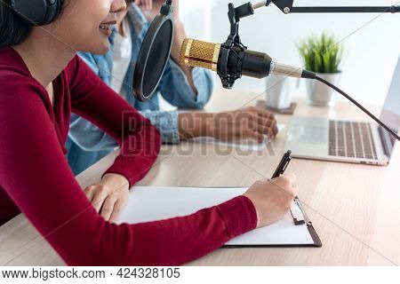Woman Was Speaking On A Morning Radio Station Broadcasting A News Program And Men Preparing The Cont