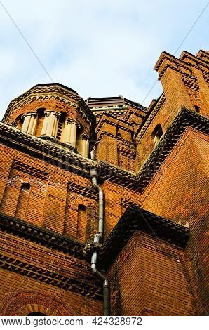 Abstract View Of Brown Brick Walls Of Three Hierarchs Church Against Blue Sky. Residence Of Bukovini