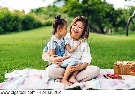 Portrait Of Happy Asian Grandmother And Little Asian Cute Girl Enjoy Relax In Summer Park.young Girl