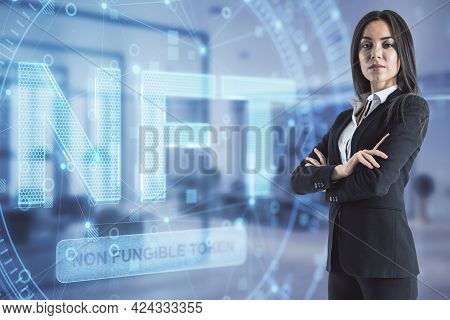 Young European Businesswoman Standing In Blurry Office Interior With Glowing Nft Non Fungible Token