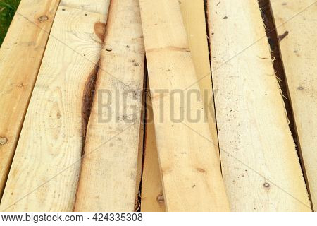 Background Of Wooden Boards At A Sawmill Or Warehouse.storage Of Cutting Boards In Production.a Bar