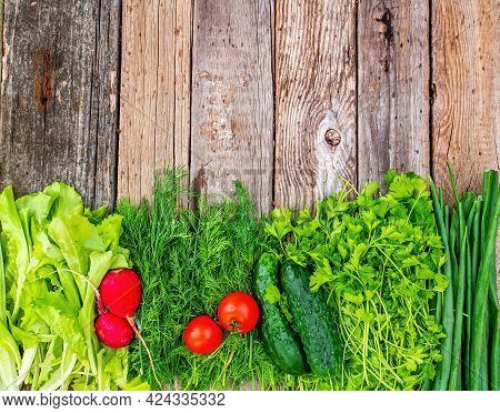 Vegetables Cucumbers With Tomatoes And Radishes On A Wooden Table. Green Cucumber. Red Tomato. Red R