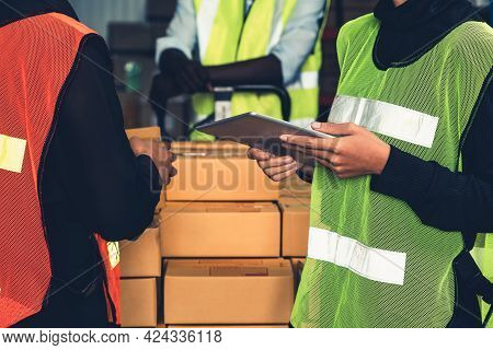 Warehouse Worker Working Together In The Storehouse . Logistics , Supply Chain And Warehouse Busines