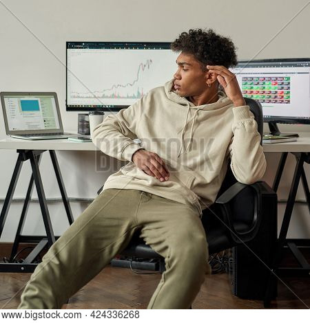 Disappointed Young Guy, Investor Analyzing Stock Charts, Looking At Laptop Screen, Sitting At Desk,