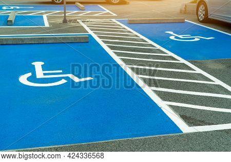 Asphalt Car Parking Lot Reserved For Handicapped Driver In Supermarket Or Shopping Mall. Car Parking