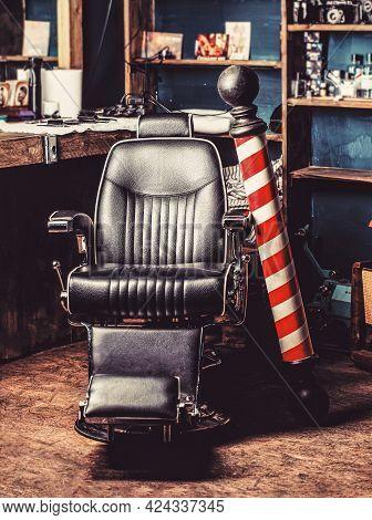 Logo Of The Barbershop, Symbol. Stylish Vintage Barber Chair. Hairstylist In Barbershop Interior. Ba