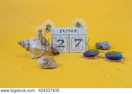 Calendar For June 27: Cubes With The Number 27, The Name Of The Month Of June In English, Shells, Se