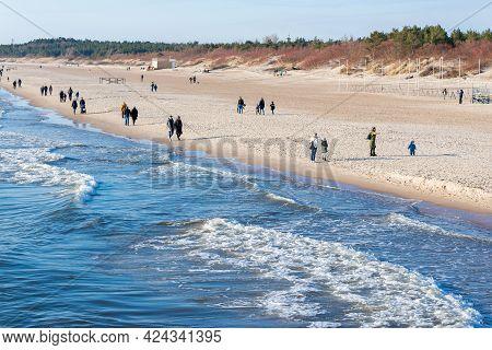 Few Of People Walking On The Beach In Spring.people Walking On The Beach In Spring.palanga,lithuania