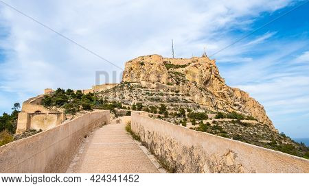 Santa Barbara Castle And Pathway On Fortification Wall On Benacantil Hill In Alicante, Spain. Neighb