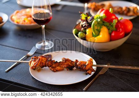 Barbecue On The Terrace. A Picnic On The Terrace For Friends. Terrace With Grill, Meat At Sunset. Fr