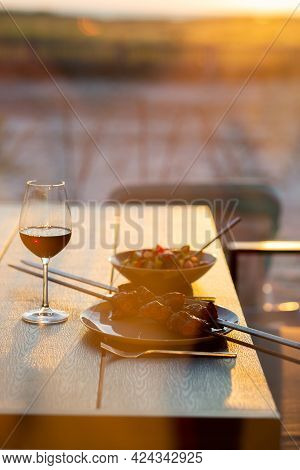 Dinner On The Terrace With Sunset And Wine. Meat With Wine On The Summer Terrace. Festive Outdoor Ta