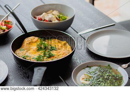 Breakfast Outside. Shrimp Omelet For Breakfast. Omelet In A Frying Pan For Breakfast. Lunch For A Ma