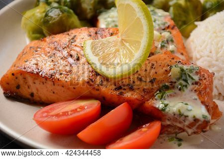 Fried Salmon Steaks. Cooked Salmon Steak With Pepper, Herbs, Lemon, Garlic, Olive Oil And Brussels S