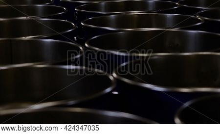 Metal Fuel Tanks At The Storage House. Video. Stack Of New Metal Barrels With With Oil Or Fuel At Th