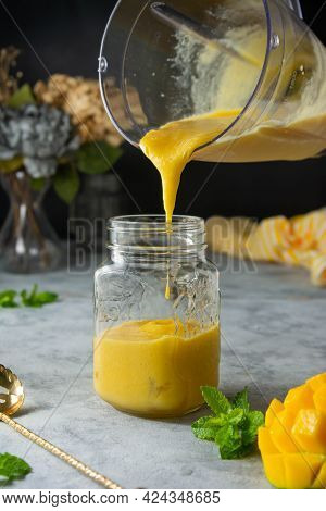 Mango Smoothie In Glass Jar With Fresh Mango Fruit And Mint Dark Background