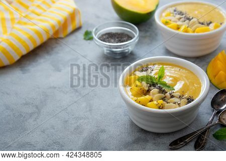 Fruit Yellow Smoothie Bowl With Fresh Mango, Banana And Chia Seeds. Copy Space For Text