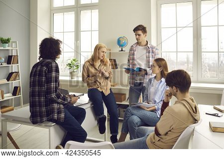 Teenage Diverse Classmates Group Talking Sharing Knowledge In Classroom